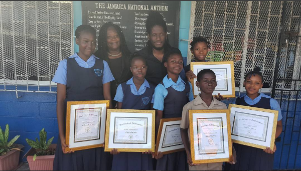 Aidonia visits Maxfield Park Primary to issue six scholarships