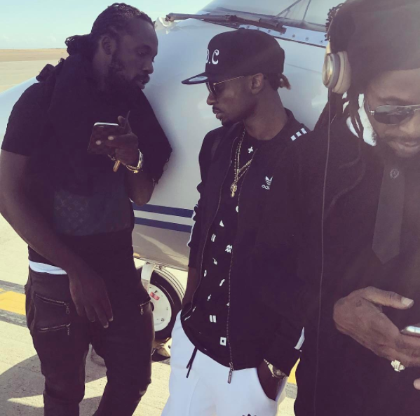 Mavado, Chris Martin and Jah Cure chilling on a private jet